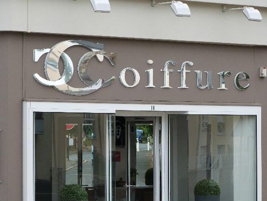 Enseigne publicitaire panneau vitrine magasin for Panneau publicitaire salon de coiffure